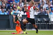 Fernando Garcia of Valencia CF Dirk Kuyt of Feyenoord during the preseason friendly match between Feyenoord and Valencia on July 23 2016 at the Kuip...