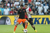 Fernando Garcia of Valencia CF Eric Botteghin of Feyenoord during the preseason friendly match between Feyenoord and Valencia on July 23 2016 at the...