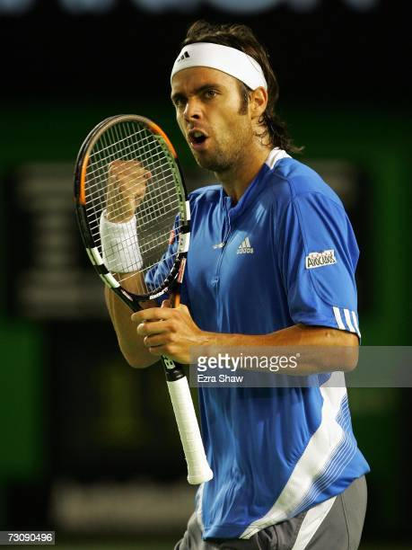 Fernando Gonzalez of Chile celebrates winning a point during his quarterfinal match against Rafael Nadal of Spain on day ten of the Australian Open...