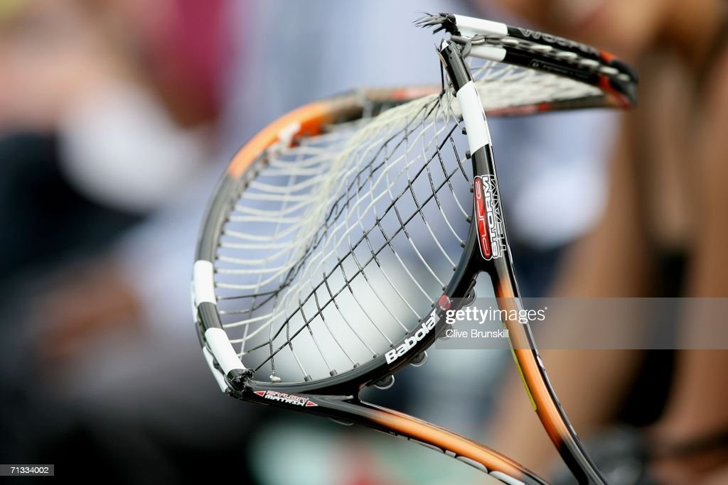 Fernando Gonzalez of Chile hands a member of the crowd his broken raquet during his match against Marat Safin of Russia during day four of the Wimbledon Lawn Tennis Championships at the All England Lawn Tennis and Croquet Club on June 29, 2006 in London, England.