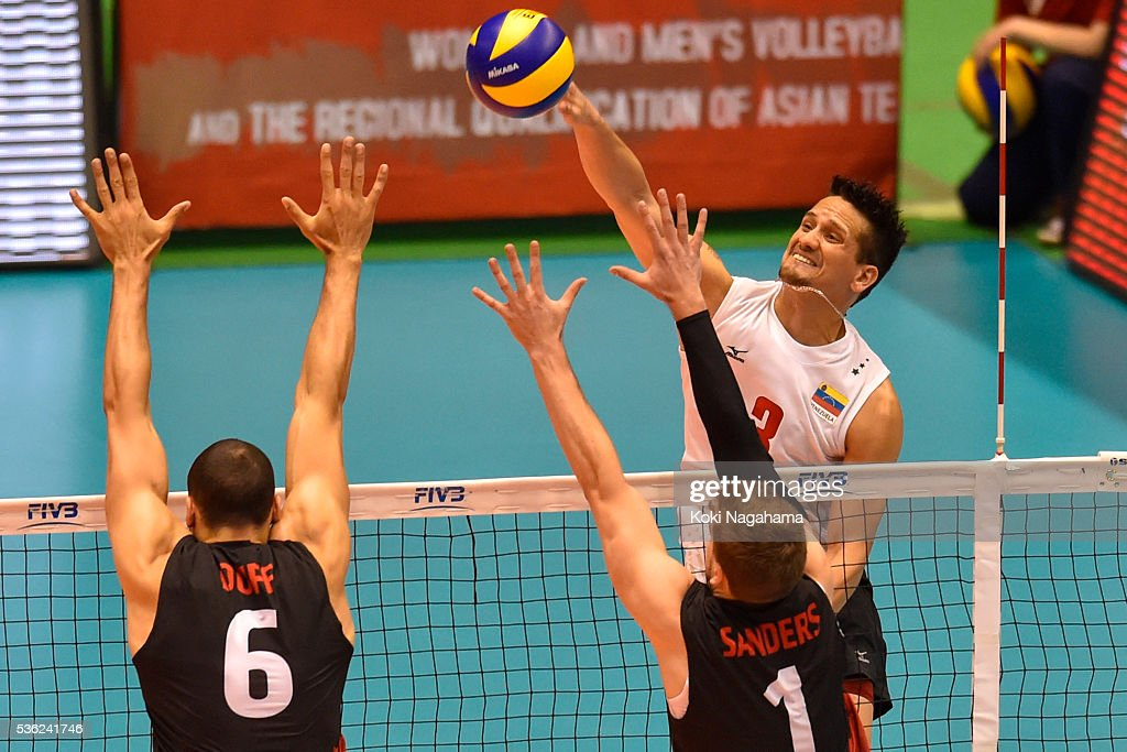 Fernando Gonzalez #3 of Venezuela spikes the ball during the Men's World Olympic Qualification game between Venezuela and Canada at Tokyo Metropolitan Gymnasium on June 1, 2016 in Tokyo, Japan.