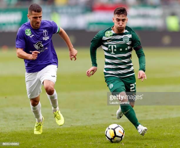 Fernando Gorriaran of Ferencvarosi TC controls the ball next to Bojan Sankovic of Ujpest FC during the Hungarian OTP Bank Liga match between...