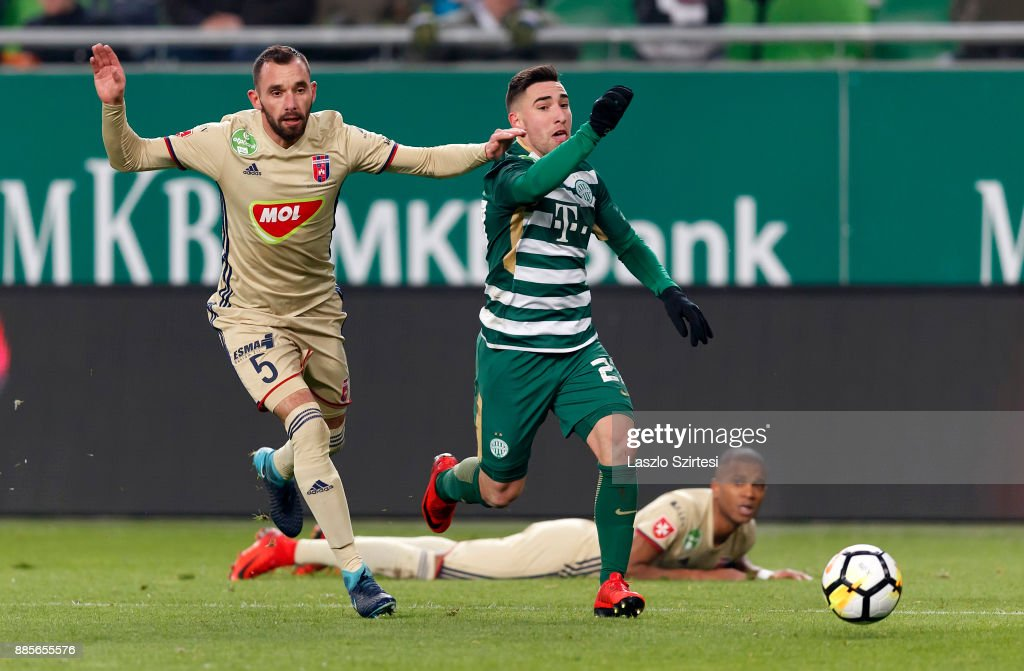 Fernando Gorriaran #27 of Ferencvarosi TC leaves Attila Fiola #5 of Videoton FC and Loic Nego (R) of Videoton FC behind during the Hungarian OTP Bank Liga match between Ferencvarosi TC and Videoton FC at Groupama Arena on December 2, 2017 in Budapest, Hungary.