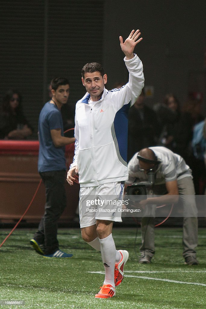 <a gi-track='captionPersonalityLinkClicked' href=/galleries/search?phrase=Fernando+Hierro&family=editorial&specificpeople=204337 ng-click='$event.stopPropagation()'>Fernando Hierro</a> salutes during 'Partido X La Ilusion' by Iker Casillas Foundation at Palacio de los Deportes on December 23, 2012 in Madrid, Spain.