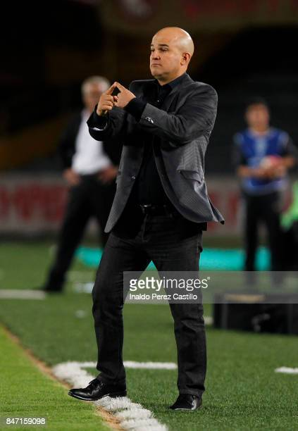 Fernando Jubero coach of Libertad gestures during a second leg match between Independiente Santa Fe and Libertad as part of round of 16 of Copa...