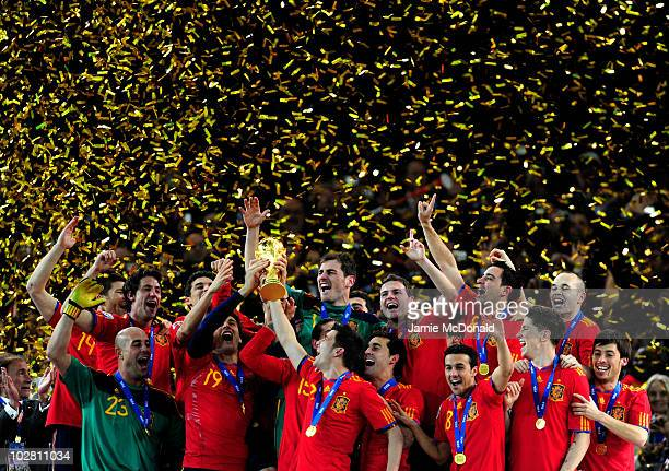 Fernando Llorente and David Villa of Spain celebrate with team mates as they lift the World Cup during the 2010 FIFA World Cup South Africa Final...