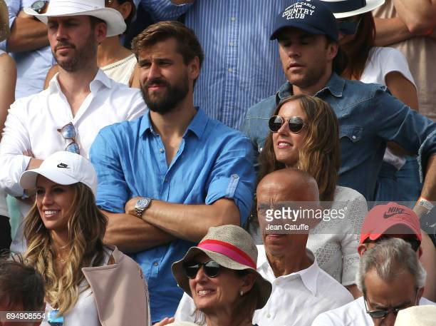 Fernando Llorente and his wife Maria Llorente attend Rafael Nadal's victory on day 15 of the 2017 French Open second Grand Slam of the season at...