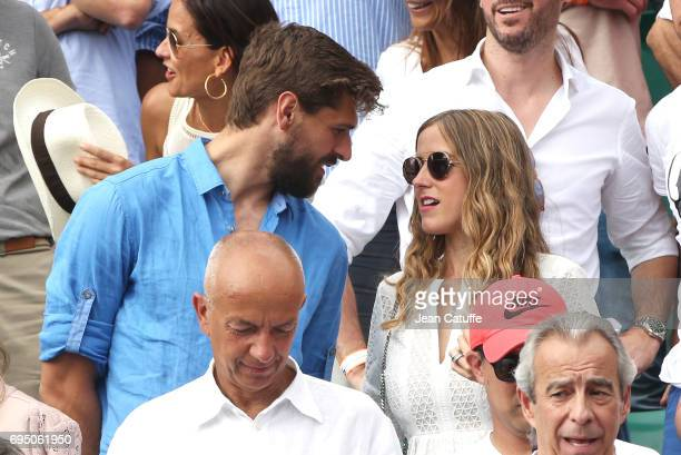 Fernando Llorente and his wife Maria Llorente attend Rafael Nadal's victory during the men's final on day 15 of the 2017 French Open second Grand...
