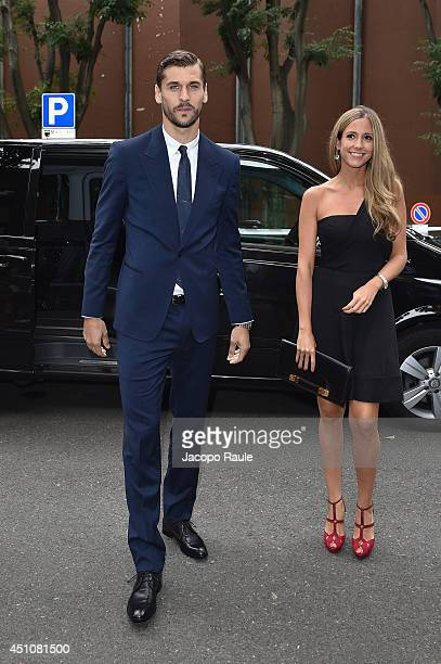 Fernando Llorente and Maria Lorente attend the Emporio Armani show during Milan Menswear Fashion Week Spring Summer 2015 on June 23 2014 in Milan...