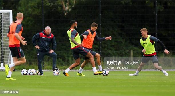 Fernando Llorente challenged by Kyle Bartley during the Swansea City Training at The Fairwood Training Ground on August 16 2017 in Swansea Wales