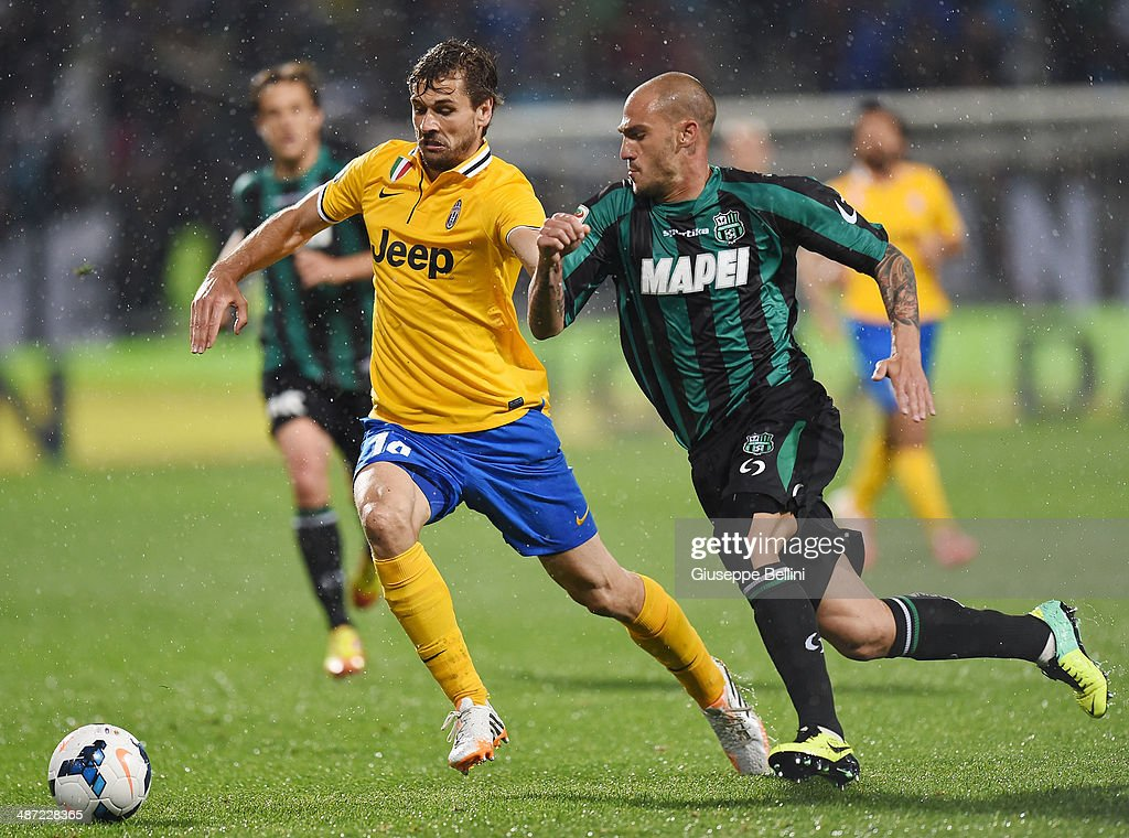 Fernando Llorente of Juventus and Paolo Cannavaro of Sassuolo in action during the Serie A match between US Sassuolo Calcio and Juventus at Mapei Stadium on April 28, 2014 in Sassuolo, Italy.