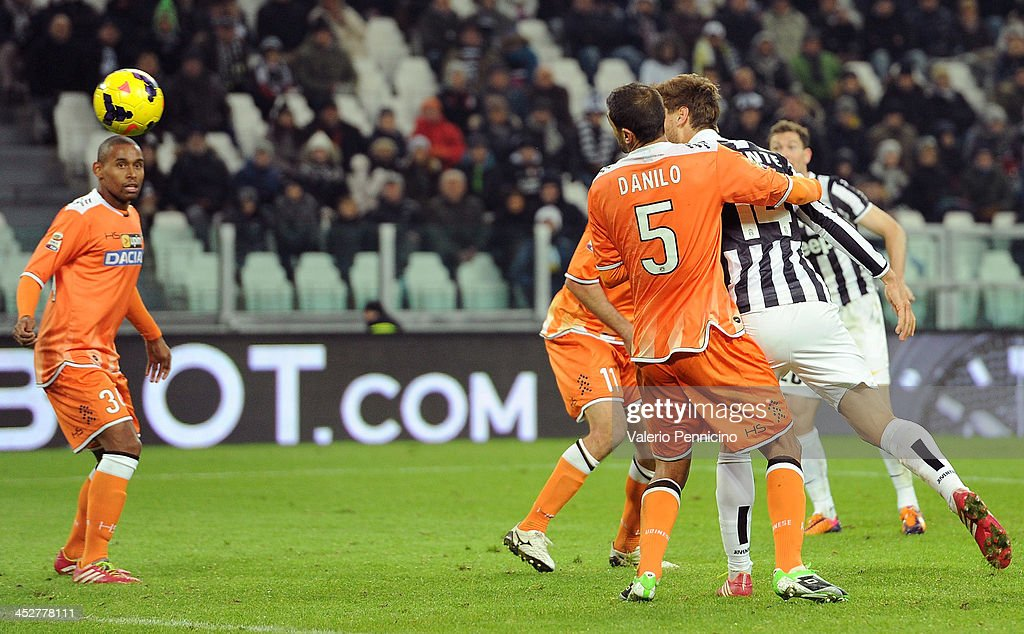 Fernando Llorente (R) of Juventus scores the opening goal during the Serie A match between Juventus and Udinese Calcio at Juventus Arena on December 1, 2013 in Turin, Italy.