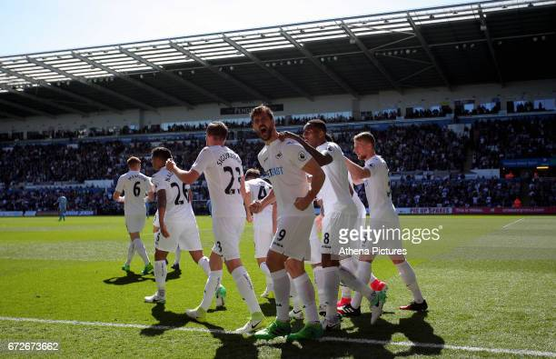 Fernando Llorente of Swansea celebrates with team mates his opening goal during the Premier League match between Swansea City and Stoke City at The...