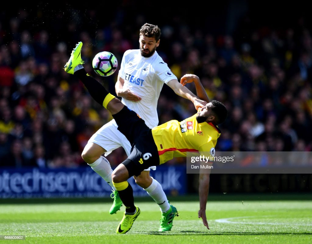 Fernando Llorente of Swansea City (L) and Adrian Mariappa of Watford (R) battle for possession during the Premier League match between Watford and Swansea City at Vicarage Road on April 15, 2017 in Watford, England.