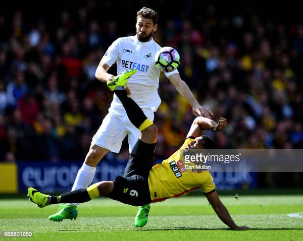 Fernando Llorente of Swansea City and Adrian Mariappa of Watford battle for possession during the Premier League match between Watford and Swansea...