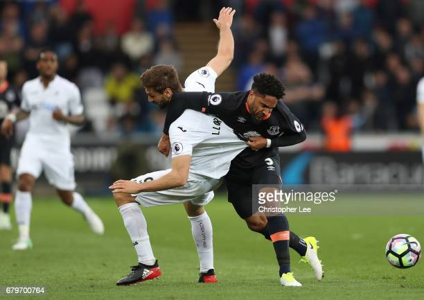 Fernando Llorente of Swansea City and Ashley Williams of Everton battle for possession during the Premier League match between Swansea City and...