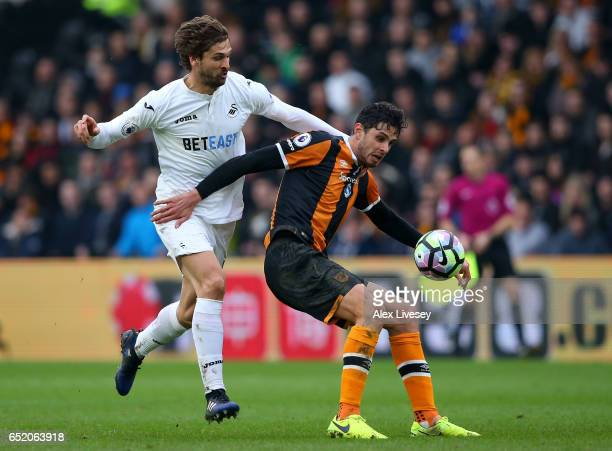 Fernando Llorente of Swansea City and Dusan Kuciak of Hull City battle for possession during the Premier League match between Hull City and Swansea...
