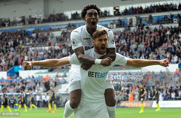 Fernando Llorente of Swansea City celebrates his equaliser with team mate Leroy Fer during the Premier League match between Swansea City and...