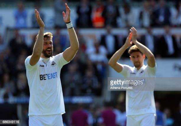 Fernando Llorente of Swansea City celebrates with team mate Federico Fernandez after the Premier League match between Swansea City and West Bromwich...