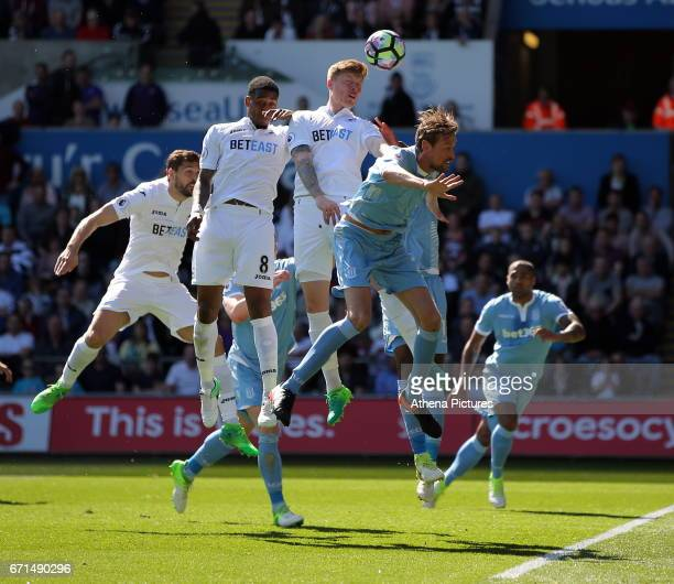 Fernando Llorente of Swansea City heads in the opening goal during the Premier League match between Swansea City and Stoke City at The Liberty...