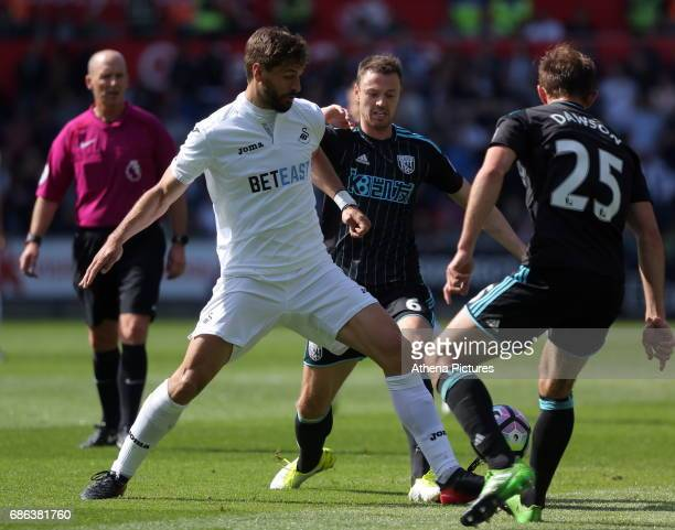 Fernando Llorente of Swansea City is challenged by Jonny Evans and Craig Dawson of West Bromwich Albion during the Premier League match between...