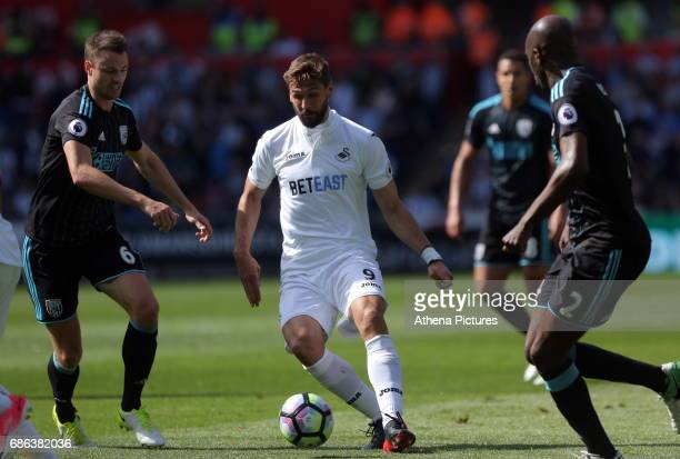 Fernando Llorente of Swansea City is closely marked by Jonny Evans and Craig Dawson of West Bromwich Albion during the Premier League match between...