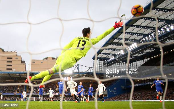 Fernando Llorente of Swansea City scores his sides first goal past Thibaut Courtois of Chelsea during the Premier League match between Chelsea and...