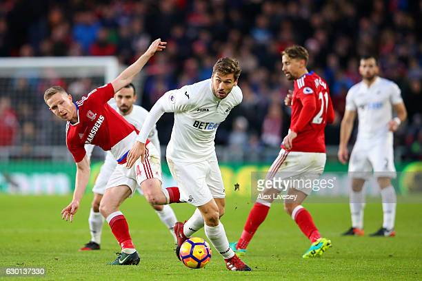 Fernando Llorente of Swansea City takes the ball past Adam Forshaw of Middlesbrough and Gaston Ramirez of Middlesbrough during the Premier League...