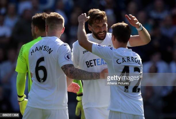 Fernando Llorente of Swansea City with team mates Alfie Mawson and Tom Carroll celebrates after the Premier League match between Swansea City and...