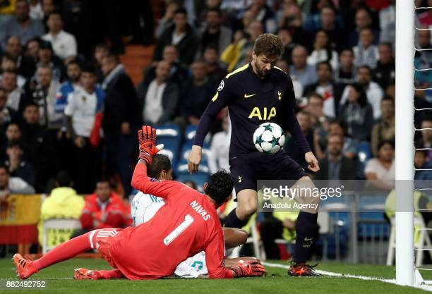 Fernando Llorente of Totenham in action against Keylor Navas and Raphael Varane of Real Madrid during UEFA Champions League Group H match between...