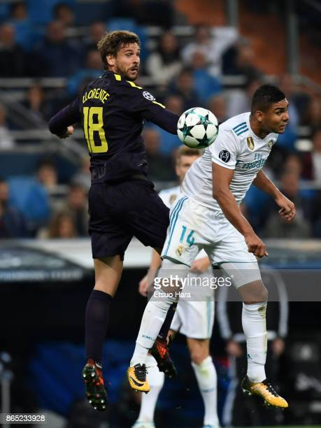 Fernando Llorente of Tottenham Hotspur and Casemiro of Real Madrid compete for the ball during the UEFA Champions League group H match between Real...