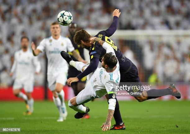 Fernando Llorente of Tottenham Hotspur and Sergio Ramos of Real Madrid battle for possession during the UEFA Champions League group H match between...