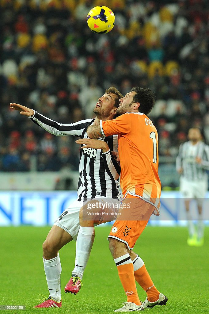 Fernando Lorente (L) of Juventus competes with Maurizio Domizzi of Udinese Calcio during the Serie A match between Juventus and Udinese Calcio at Juventus Arena on December 1, 2013 in Turin, Italy.