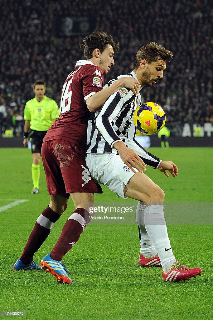 Fernando Lorente (R) of Juventus is challenged by Matteo Darmian of Torino FC during the Serie A match between Juventus and Torino FC at Juventus Arena on February 23, 2014 in Turin, Italy.