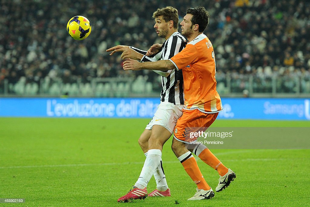 Fernando Lorente (L) of Juventus is challenged by Maurizio Domizzi of Udinese Calcio during the Serie A match between Juventus and Udinese Calcio at Juventus Arena on December 1, 2013 in Turin, Italy.