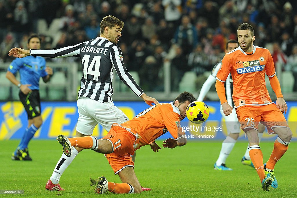 Fernando Lorente (L) of Juventus tackles Maurizio Domizzi of Udinese Calcio during the Serie A match between Juventus and Udinese Calcio at Juventus Arena on December 1, 2013 in Turin, Italy.
