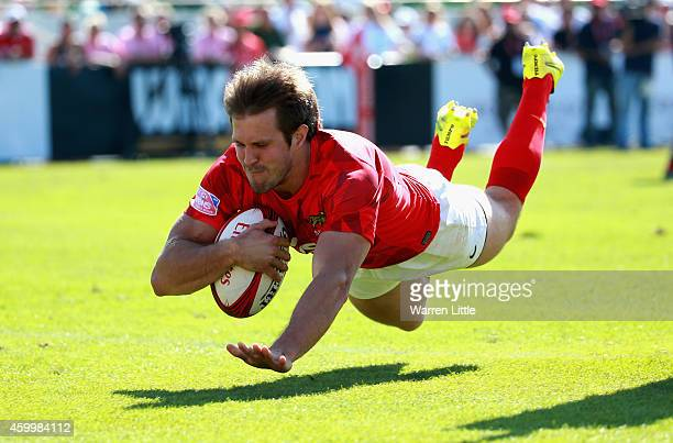 Fernando Luna of Argentina scores a try against Brazil during day one of the Emirates Dubai Sevens HSBC Sevens World Series on December 5 2014 in...