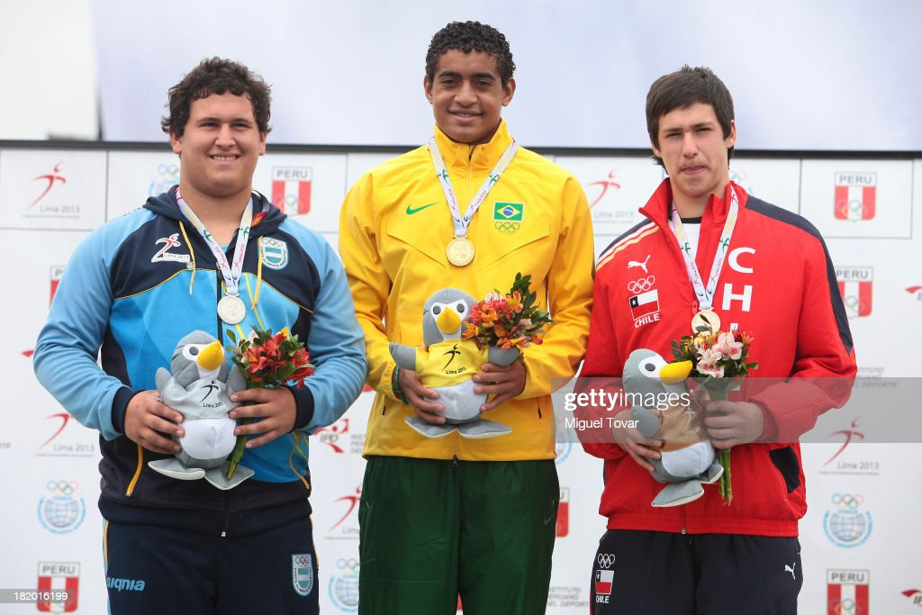Fernando Mansilla of Argentina, Cleverson Pereira of Brazil and Jose Ballivian of Chile in the podium of Discus Throw Men's as part of the I ODESUR South American Youth Games at Estadio Miguel Grau on September 27, 2013 in Lima, Peru.