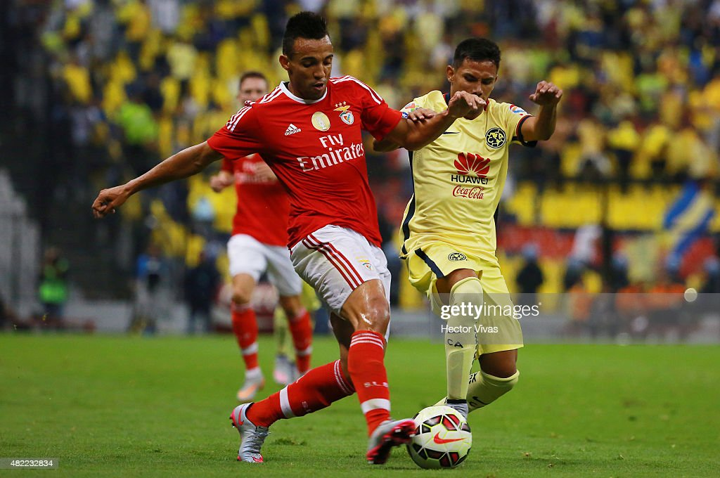Fernando Marcal of Benfica (L) struggles for the ball with Carlos Rosel of America (R) during a match between America and Benfica as part of the International Champions Cup 2015 at Azteca Stadium on July 28, 2015 in Mexico City, Mexico.