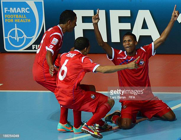 Fernando Mena of Panama celebrates with team mates after scoring his teams eight goal during the FIFA Futsal World Cup Group B match between Panama...