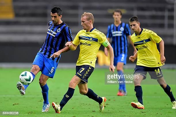 Fernando Menegazzo of Club Brugge kicks the ball away of Thomas Kahlenberg of Brondby IF during the UEFA Europa League third qualifying round second...