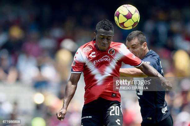 Fernando Meneses of Veracruz vies for the ball with Nicolas Castillo of Pumas during their Mexican Clausura 2017 tournament football match at the...