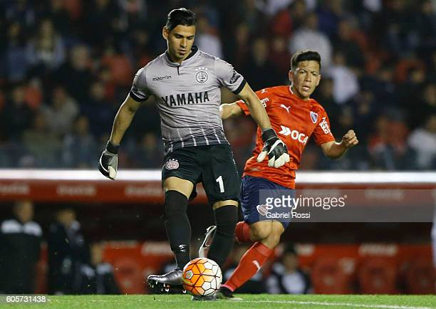 Fernando Monetti goalkeeper of Lanus fights for the ball with Ezequiel Barco of Independiente during a match between Independiente and Lanus as part...