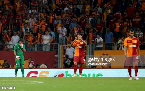 Fernando Muslera and Ahmet Calik of Galatasaray get upset after the penalty goal of Ostersunds during the UEFA Europa League second qualifying round...