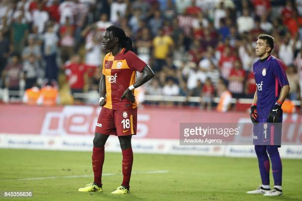 Fernando Muslera and Bafetimbi Gomis of Galatasaray react at the end of the 4th week of the Turkish Super Lig match between Antalyaspor and...