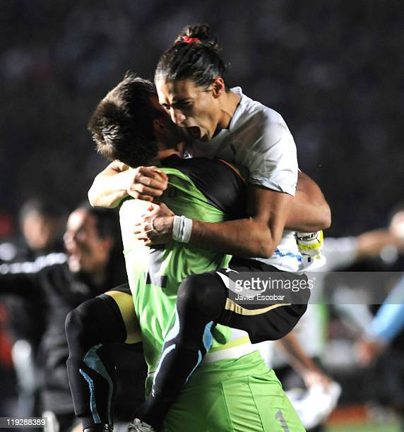 Fernando Muslera and Martín Cáceres of Uruguay celebrate after the game between Argentina and Uruguay as part of quarter final of the 2011 Copa...