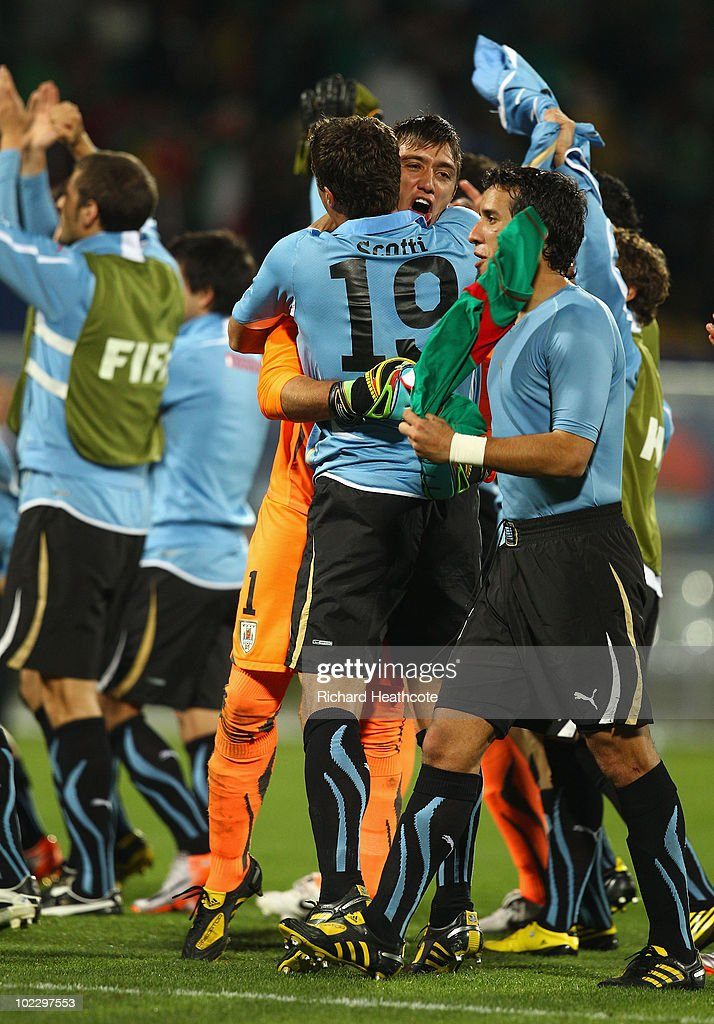 Fernando Muslera of Uruguay celebrates with team mate Andres Scotti after victory in the 2010 FIFA World Cup South Africa Group A match between...