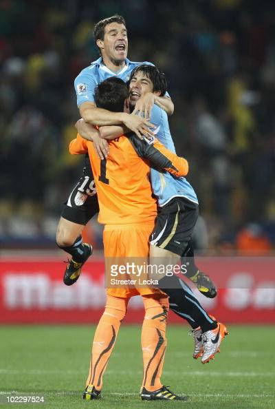 Fernando Muslera of Uruguay celebrates with team mates Andres Scotti and Jorge Fucile after victory in the 2010 FIFA World Cup South Africa Group A...