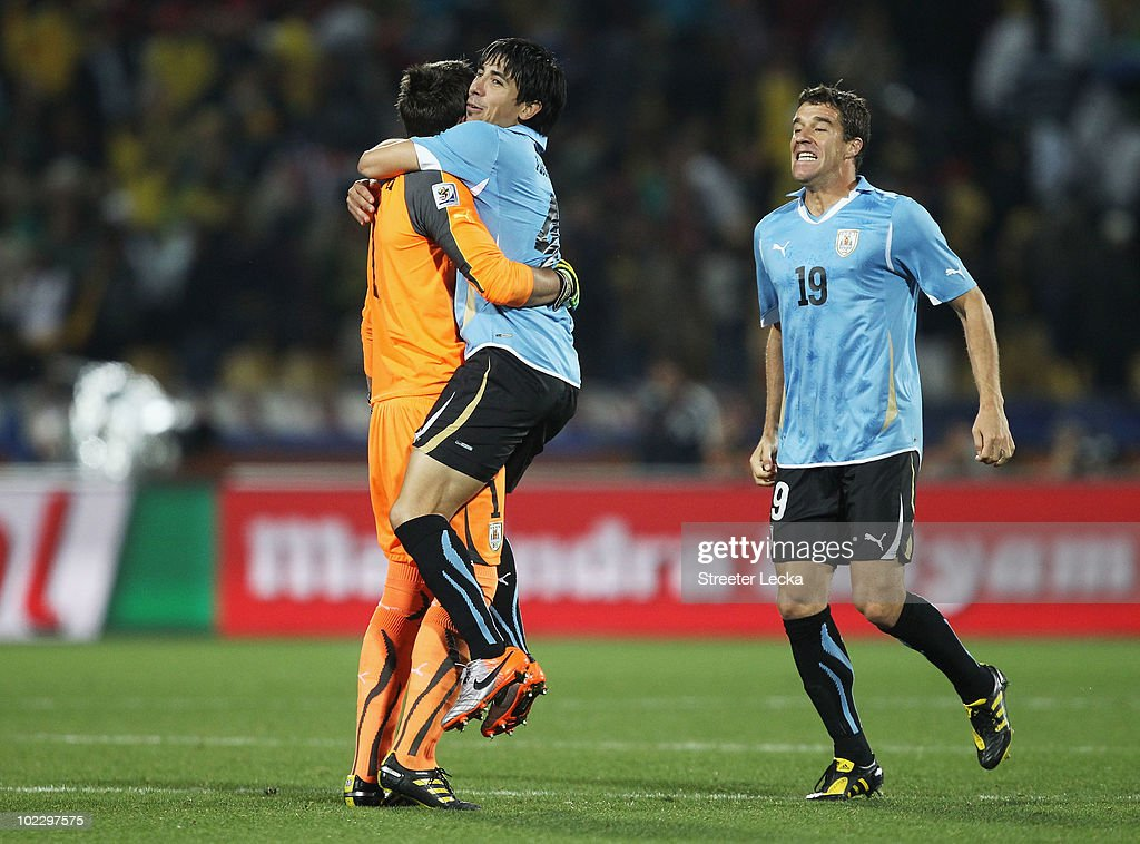 Fernando Muslera of Uruguay celebrates with team mates Jorge Fucile and Andres Scotti after victory in the 2010 FIFA World Cup South Africa Group A...