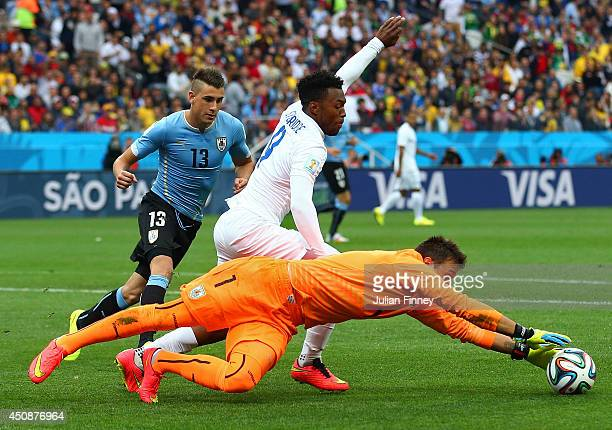 Fernando Muslera of Uruguay makes a save against Daniel Sturridge of England during the 2014 FIFA World Cup Brazil Group D match between Uruguay and...